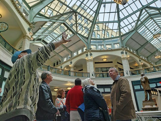 Steve Kessel (left) points out features of the Plankinton Arcade building in the old Grand Avenue mall during a Skywaukee tour with Historic Milwaukee on March 2, 2019.