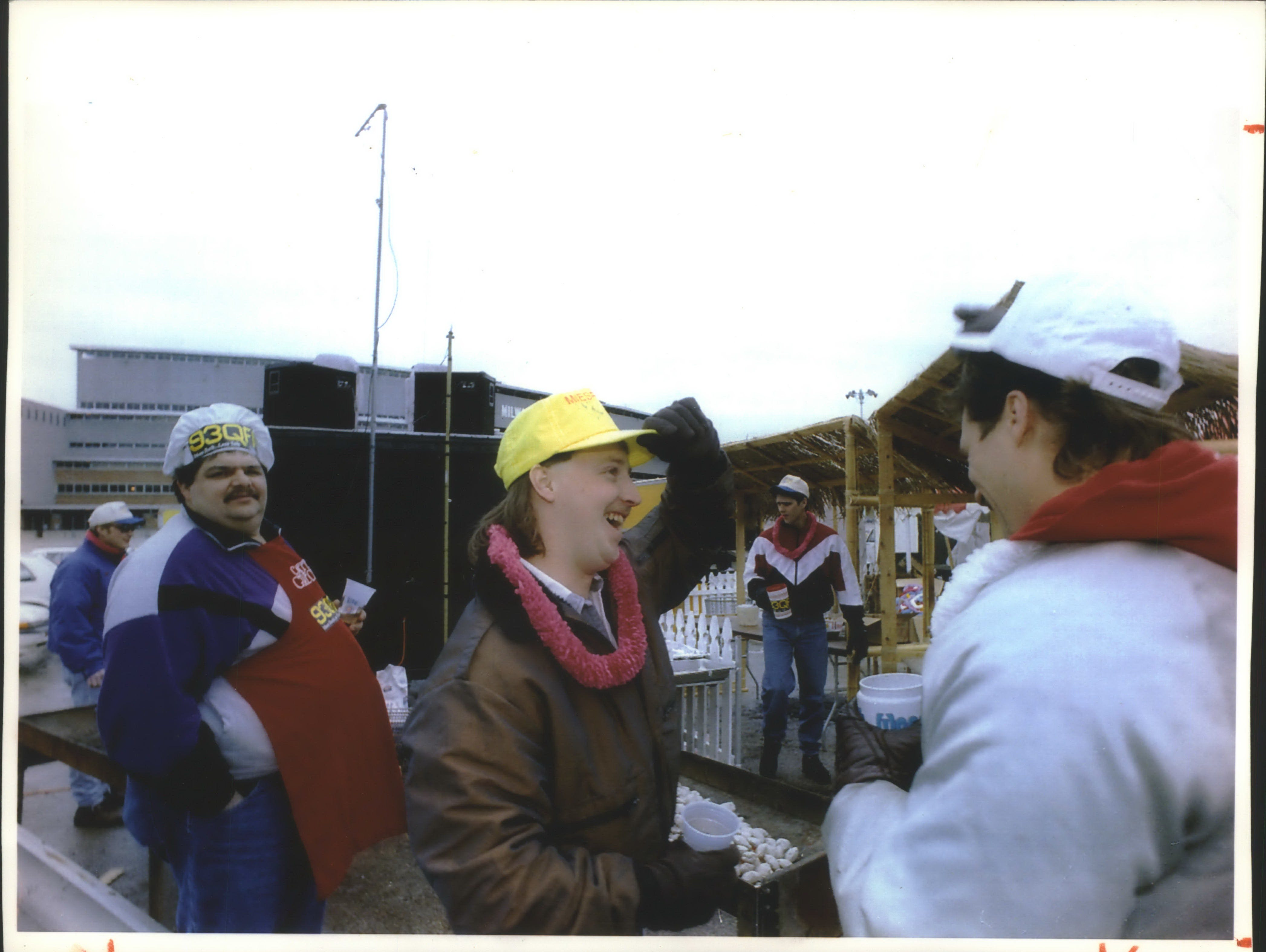 Gearing up for the start of the Milwaukee Brewers' 1993 home opener against the California Angels, Thomas Greco (from left) , Tracy Messner, John Morrill and Chuck Miesfeld get WQFM-FM's tailgate party under way at County Stadium on April 12, 1993. (The Brewers lost, 12-5.)