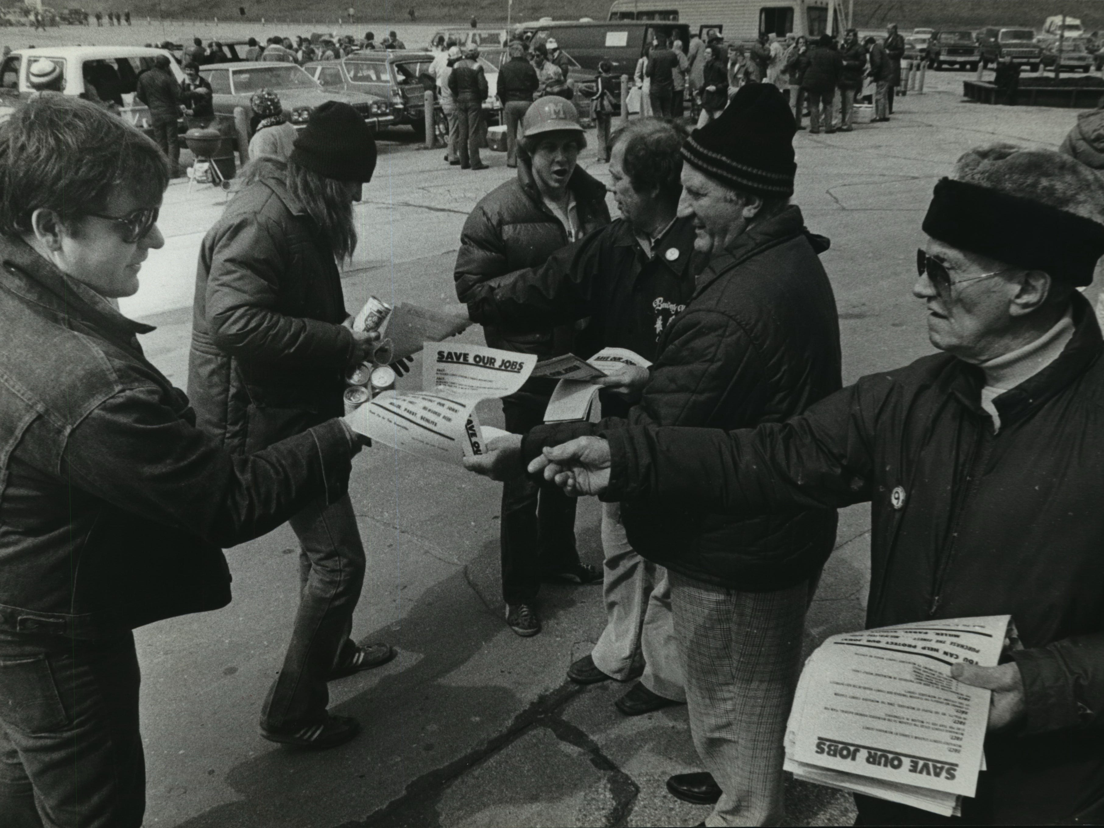 """Brewery workers from Local 9 hand out leaflets outside County Stadium before opening day on April 10, 1980, urging fans to not drink the new """"foreign"""" beer at the stadium, Hamm's. This photo was published in the April 11, 1980, Milwaukee Journal. (The Brewers won the home opener, 9-5, over the Boston Red Sox.)"""