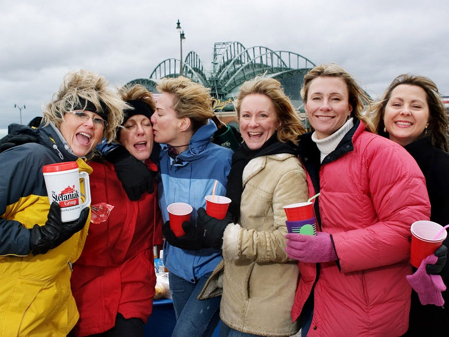 Ann Johnson (from left), Terry Matz, Cindy Krauss, Denise Clark, Kathy Schebu and Jill Lenore Goehrig get into the spirit at Miller Park for the Milwaukee Brewers' home opener on April 3, 2006. The Brewers beat the Pittsburgh Pirates, 5-2.