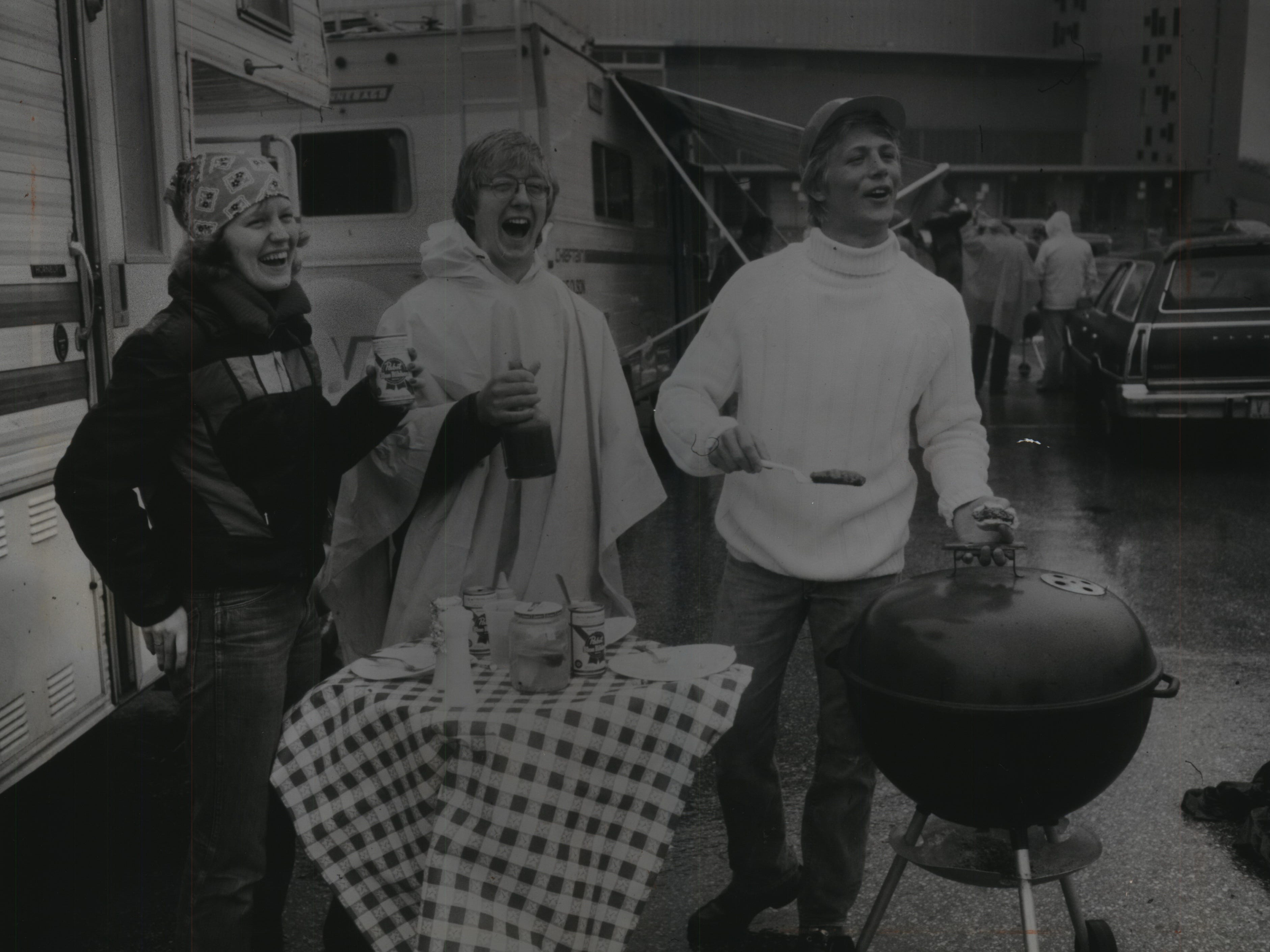 Despite the rain, a brothers-and-sister act, Vicki and David Noll of Johnson Creek, and Leonard Noll of Waukesha (left to right), cook out in the County Stadium parking lot on what was supposed to be opening day of the 1978 baseball season on April 6, 1978. The game itself was postponed, but tailgating went on as scheduled. (The Brewers won the eventual home opener on April 7, 11-3 over the Baltimore Orioles.) This photo was on the front page of the April 7, 1978, Milwaukee Sentinel.