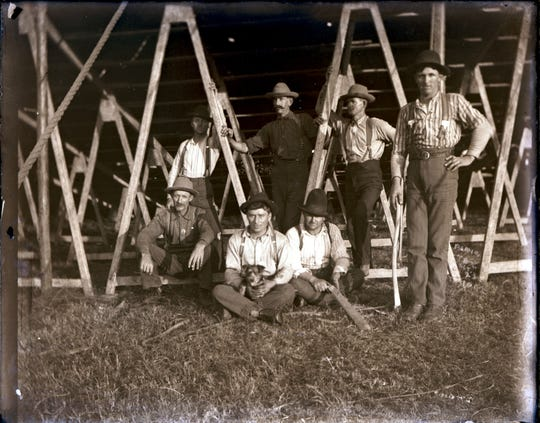 "Roustabouts hired to put up and take down tents and sideshows for a circus at the turn of the last century pose for a photographer. This photo was one of many provided by Circus World Museum in Baraboo to the production team of the ""Dumbo"" remake."