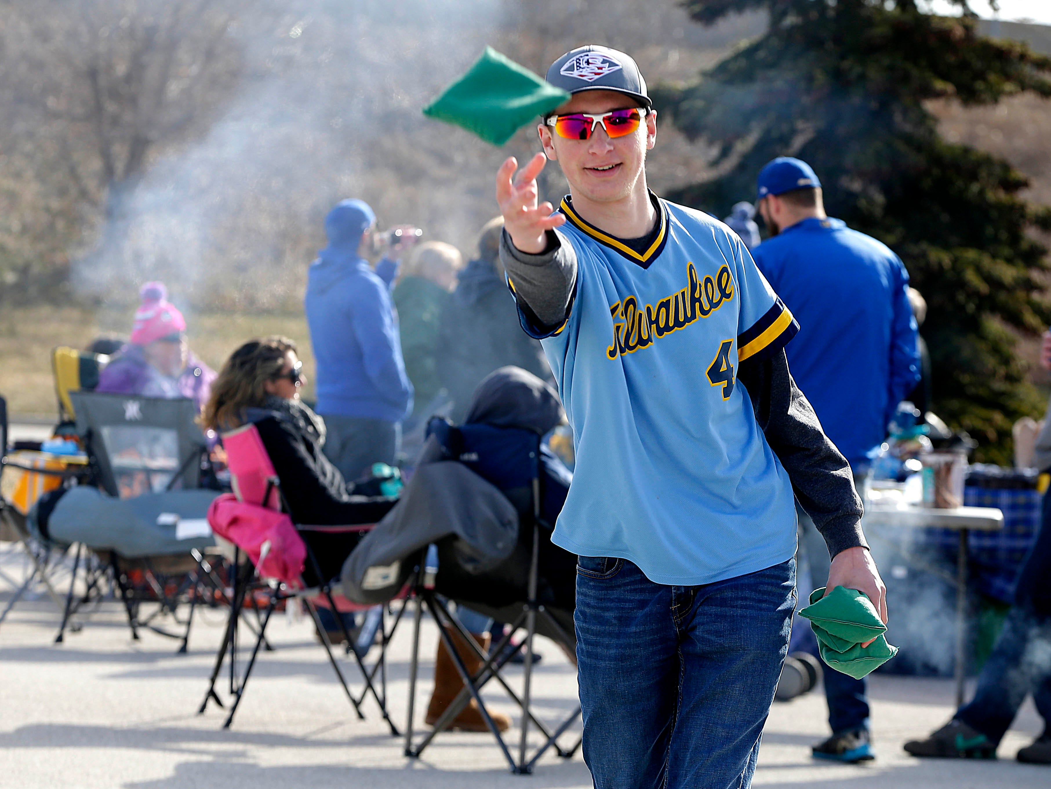 Ben Ludtke celebrates his third opening day playing cornhole before the Milwaukee Brewers' home opener against the St. Louis Cardinals at Miller Park on April 2, 2018. In the game, the Cardinals beat the Brewers, 8-4.