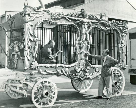 Walt Disney (right) stands next to  Carl Hagenbeck Cage Wagon No. 65  around 1960. Disney loved the circus and collected wagons which he donated to Circus World Museum in Baraboo in 1962.