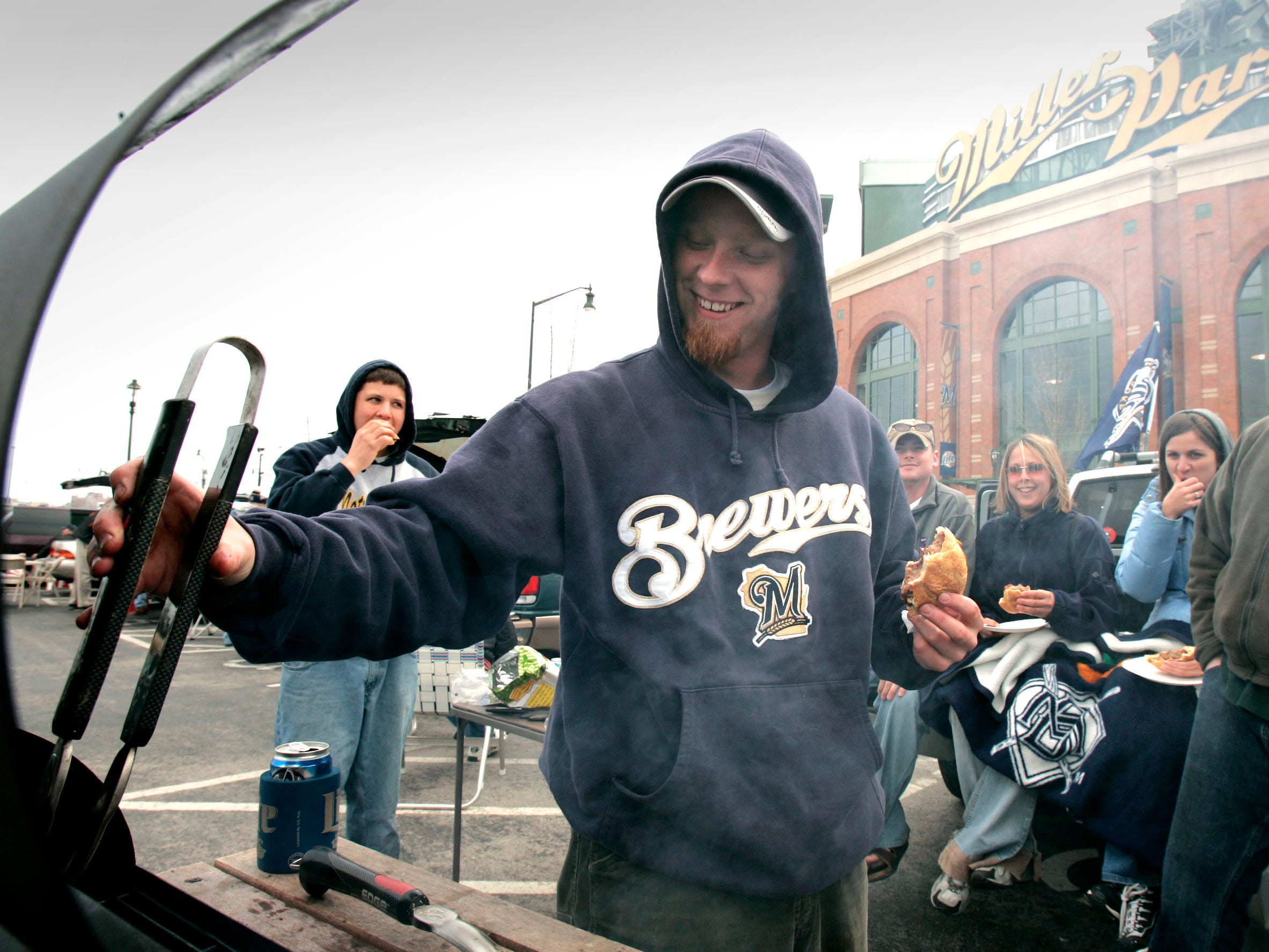 Milwaukee Brewers fan Ryan VandeWalle of Green Bay tailgates before the home opener April 11, 2005, at Miller Park. The Brewers beat the Pittsburgh Pirates, 6-2, in the opener.