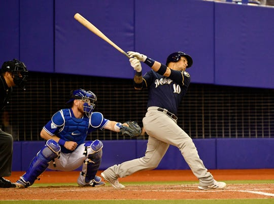 Brewers catcher Yasmani Grandal doubles in the fifth inning.