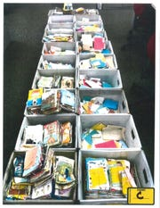 Bins of greeting cards stolen by Ebony L. Smith are laid out as evidence. Smith admitted to stealing more than 6,000 greeting cards filled with cash and checks in Wauwatosa from April 2017 to January 2018.
