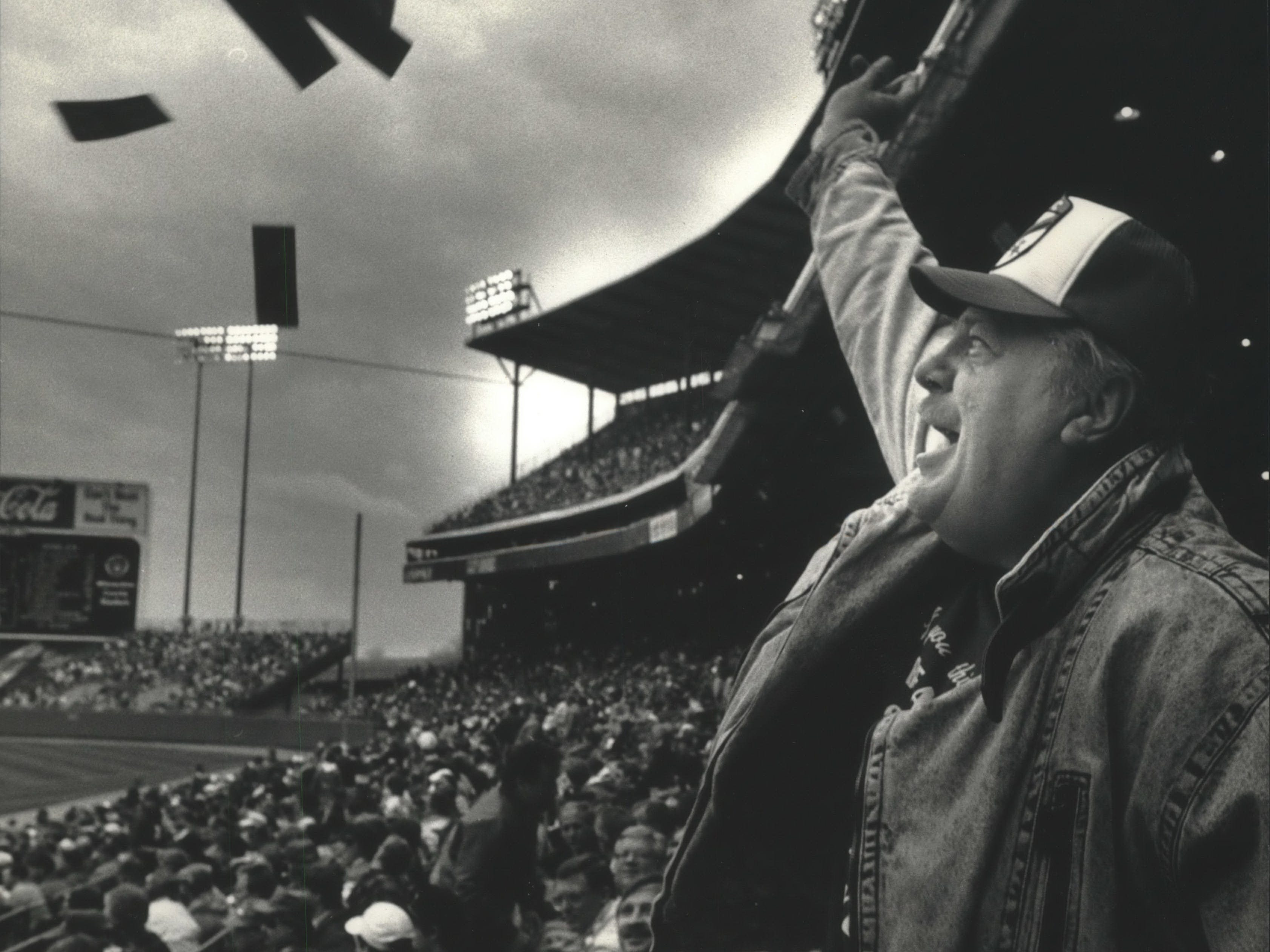 Meilahn Mystandke of Ripon throws fake money around at the Milwaukee Brewers' 1991 home opener to protest high baseball salaries on April 15, 1991. The Brewers lost to the Baltimore Orioles, 7-2. This photo was published in the April 17, 1991, Milwaukee Journal.