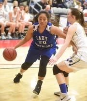 Cotter's Samantha Sanchez drives to the basket for the East during the North Central Arkansas All-Star game Monday night at Harrison.