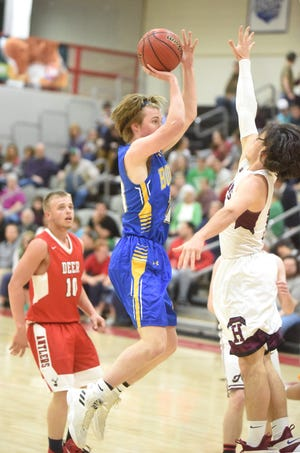 Mountain Home's Bayler Crecelius puts up a shot for the East during the North Central Arkansas All-Star game Monday night at Harrison.