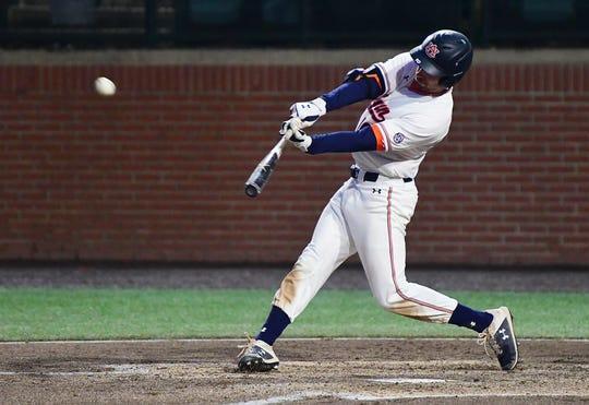 Auburn third baseman Edouard Julien (10) hits a home run against UT Martin on Tuesday, March 5, 2019 in Auburn, Ala.