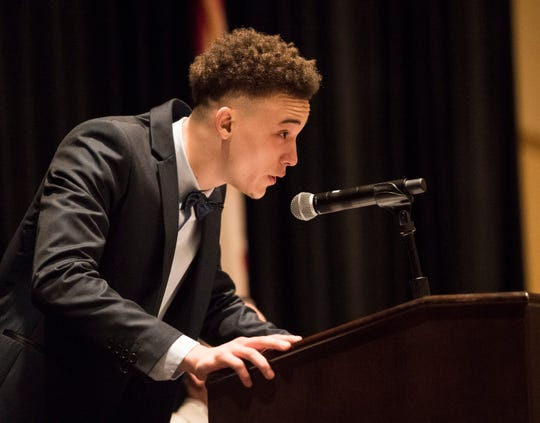 Sacred Heart Jayden Stone accepts the boys 2A player of the year during the 2019 Mr. and Miss Basketball Banquet at the Renaissance Hotel in Montgomery, Ala., on Tuesday, March 26, 2019.