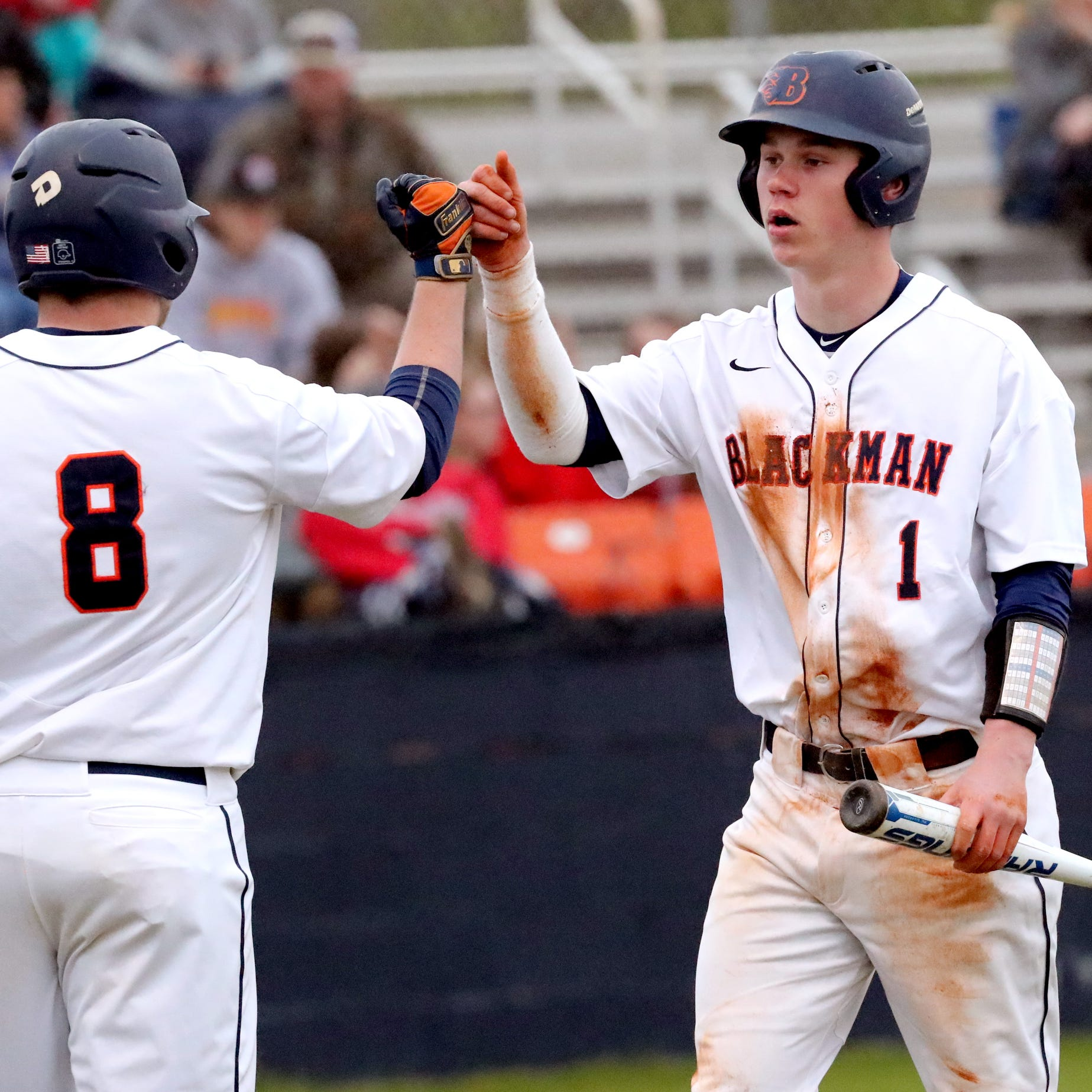 Blackman's Conner Murphy (1) celebrates a run against Stewarts Creek, with Blackman's Christian Sanderson (8) on Monday, March 25, 2019.
