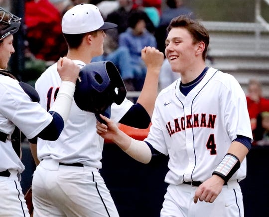 Blackman's Blaze Bell (4) celebrates a run against Stewarts Creek, with Blackman's Drew Beam (11) and Blackman's David Milam (10) on Monday, March 25, 2019.