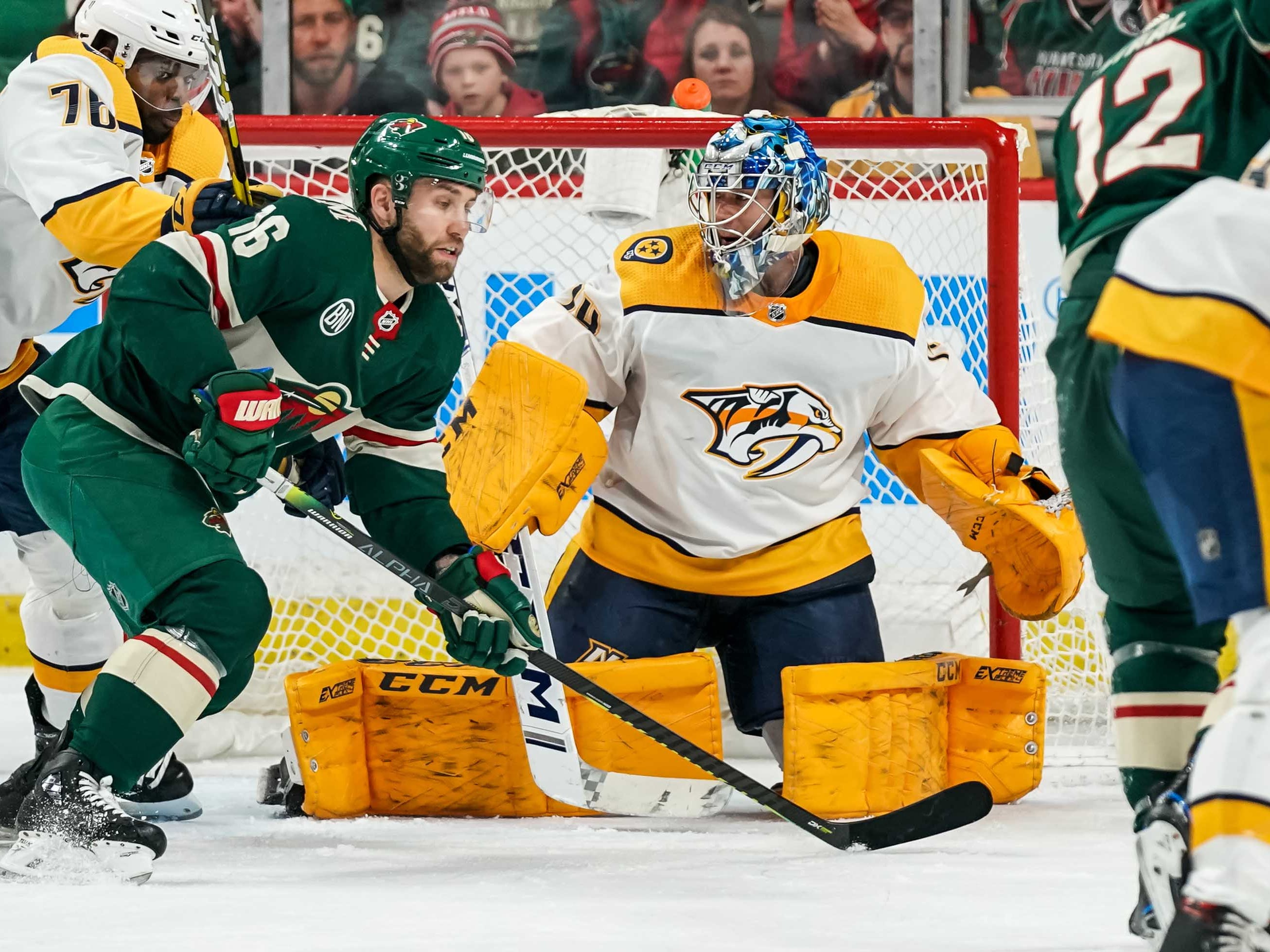 Nashville Predators goalie Juuse Saros (74) makes a save during the third period against the Minnesota Wild at Xcel Energy Center.