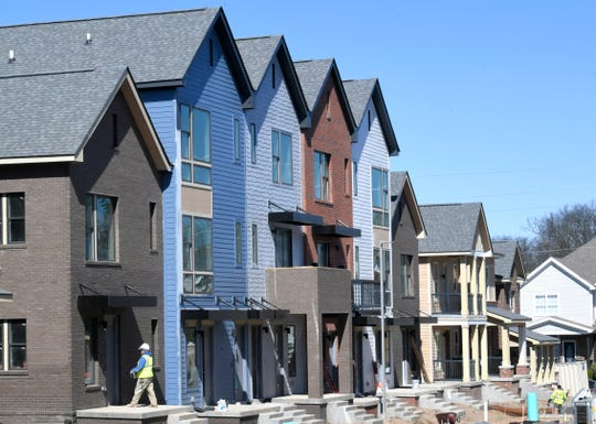 Construction workers build new homes in the Kirkpatrick Park residential development in Nashville on Tuesday, March 26, 2019 where Mayor David Briley held a press conference announcing $500 million affordable housing push over the next 10 years.