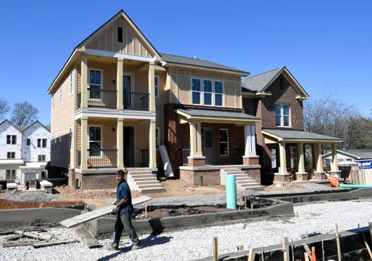 Construction workers build new homes in the Kirkpatrick Park residential development in Nashville on Tuesday, March 26, 2019. Mayor David Briley held a press conference announcing $500 million affordable housing push over the next 10 years.