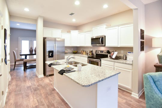 Kitchens at Bradburn Village are complete with stainless appliances, granite countertops and an island.