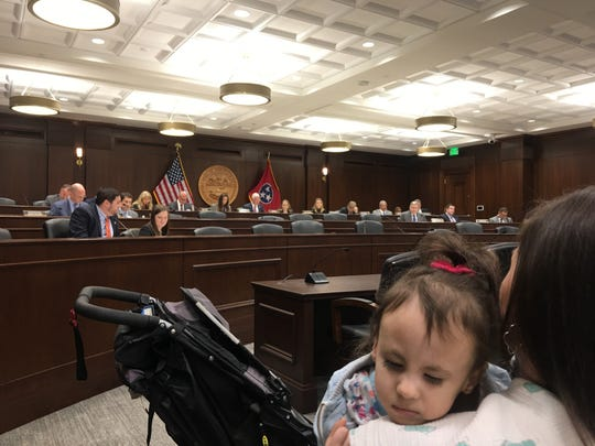 Four-year-old Dylan Waibl, who was born with chromosomal disorder Trisomy 18, rests on her mom's shoulder during a House Insurance Committee hearing. The lawmakers passed on legislation that would provide a pathway to Medicaid coverage for children like Dylan, who have severe disabilities but can't qualify for TennCare services because their family's income is too high.