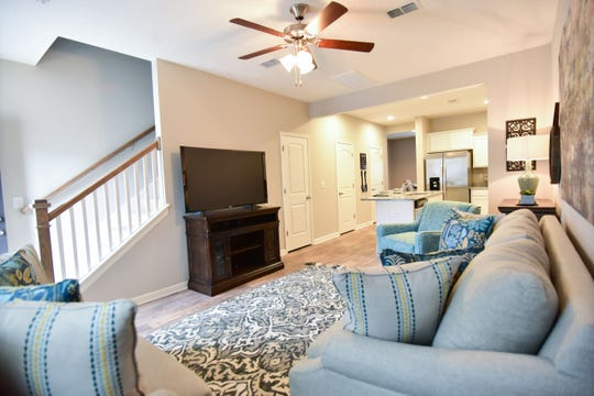 This photo of Ole South's model home in Bradburn Village shows the floor plan with the kitchen open to the living area.