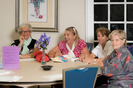 Socialization and conversation is part of a daily visit to the Golden Gate Senior Center.
