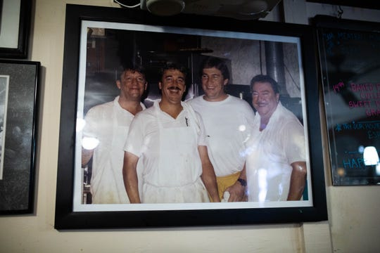 An old photo of the Hickey brothers with their father hangs in Di Julio's in East Naples on March 22, 2019.