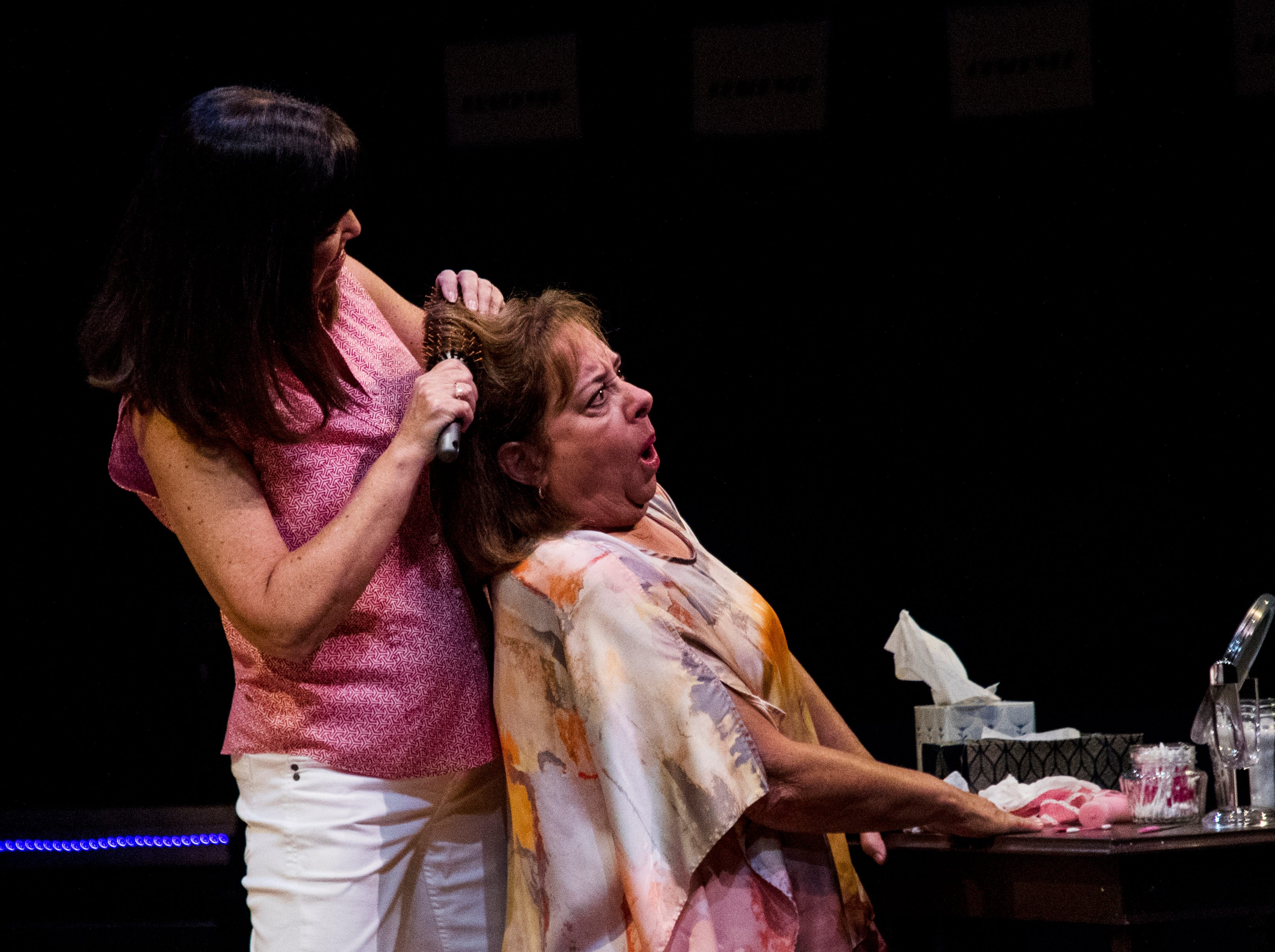 Jo Atkinson playing Deedra and Linda Mizeur playing Charlie act out a scene during a dress rehearsel in Always a Bridesmaid. It is playing at the Tobye Theater at Sugden Community Theater on 5th Ave. in Naples from March 27-April 20.