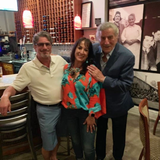 Grammy award-winner Tony Bennett stands with owners Peter and Maria DellaRocca at Parmesan Pete's on Sunday, March 24, 2019. Bennett dined at the family-owned restaurant the night before performing at Artis—Naples.