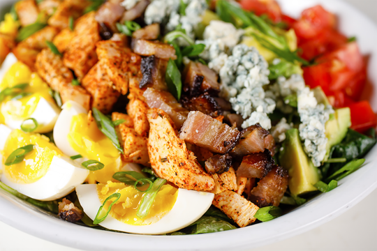 A Cobb salad is one of the healthier new bar snacks available for happy hour at The Local restaurant in North Naples.