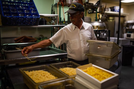 Mark Hickey prepares pasta at Di Julio's in East Naples on March 22, 2019. Hickey and his two brothers own and operate the Italian-American restaurant.