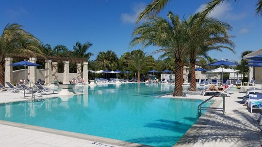 The Bonita Bay Club's Tennis and Aquatic Center's pool includes four lap lanes, a beach entry, and a spa.