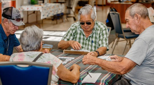 Seniors enjoying a game of dominoes at the Golden Gate Senior Center.