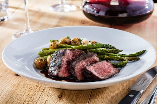 Seasons 52's Hello Spring menu includes Wood-Grilled Bistro Steak served with roasted asparagus, parsley potatoes and a red wine sauce.