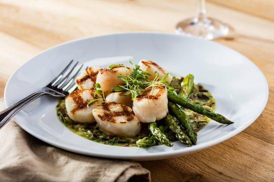Seasons 52's Hello Spring menu includes Wood-Grilled Sea Scallops served with roasted asparagus and lemongrass wild rice pilaf.