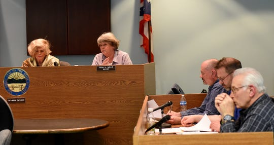 Buckeye Lake Mayor Peggy Wells (right) discusses video cameras in council chambers and other issues while seated next to council president Catherine Zwissler (left) during a village council meeting on Monday, March 25, 2019.
