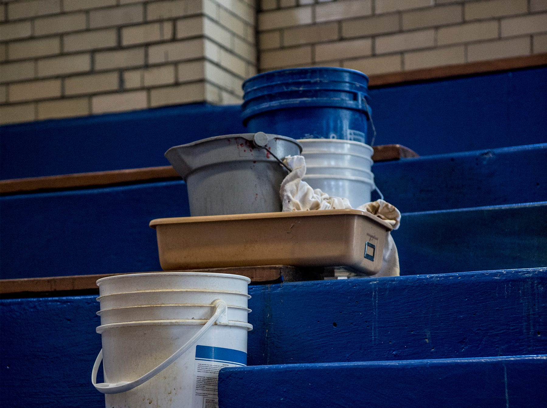 Lakewood Schools are looking to pass a levy this May to help their elementary schools. Buckets are laid out all over Hebron Elementary, like these in the gymnasium, when it rains to catch water dripping in. The children are forced to play around the buckets.
