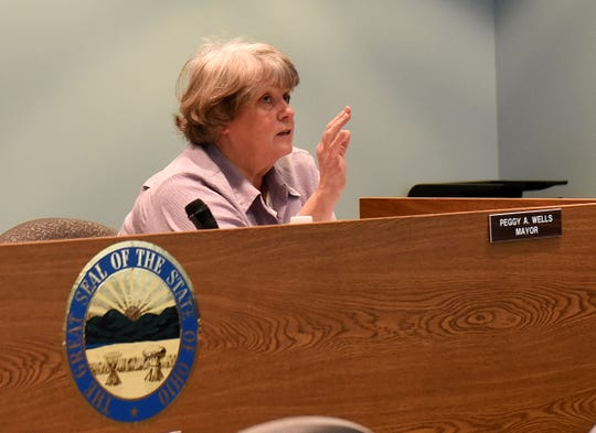 Buckeye Lake Mayor Peggy Wells discusses video cameras in council chambers and other issues during a village council meeting on Monday, March 25, 2019.