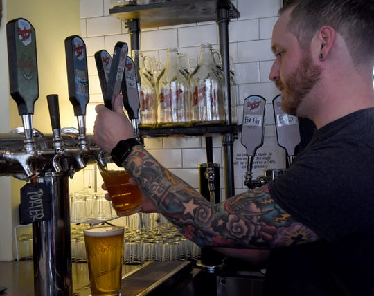 Kyle Maite pours beer at Buckeye Lake Brewery in Buckeye Lake. With the dam project completed businesses along the lake are expecting a busy summer of 2019.