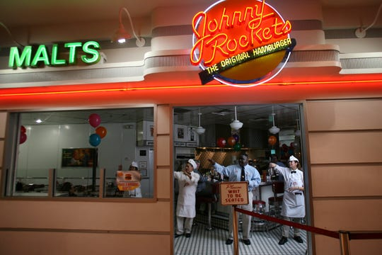 Staff dance at Johnny Rockets at the Garden State Plaza in Paramus in 2009.