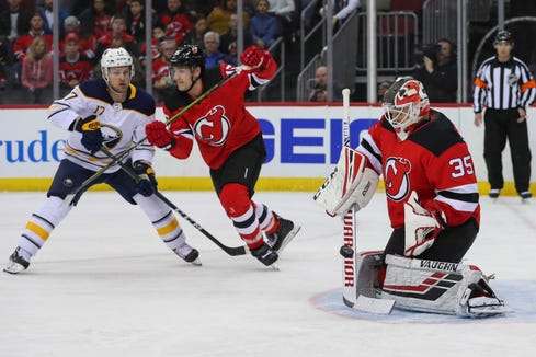 Mar 25, 2019; Newark, NJ, USA; New Jersey Devils goaltender Cory Schneider (35) makes a save during the first period of their game against the Buffalo Sabres at Prudential Center.