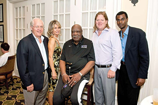 Steve and Beth Danhauser, Cal Ramsey of the New York Knicks, Tim Kopec, and Michael Linton at the Rusty Staub Foundation event in Demarest in June of 2011.