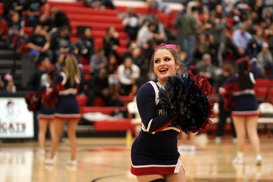 Wildcat junior Ciera Wood fires up the crowd during a Wildcat basketball game.