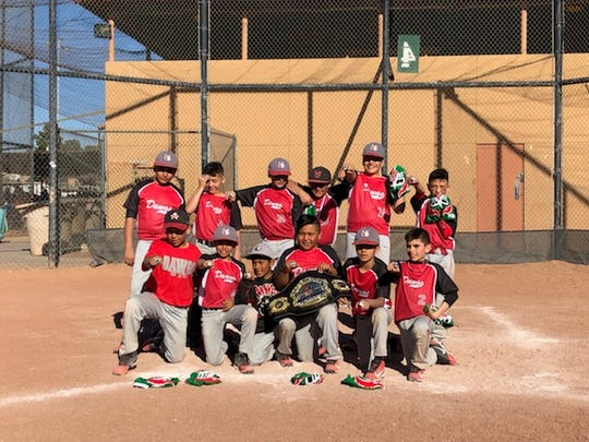 The Las Cruces Dawgs pose for a photo Sunday afternoon after winning the Silver championship in their age division at the USSSA Bataan Death March Memorial Super NIT Tournament, which took place Friday to Sunday, March 22-24, 2019 in Las Cruces.