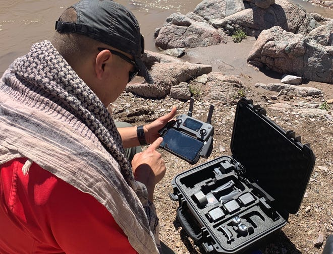 Mesilla Valley Search and Rescue's Aaron Marquez pilots the team's newest tool, the DJI Mavic 2 C , during a difficult mission Sunday, March 24, 2019, in the Gila.