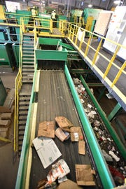 Conveyor belts inside the Eight Mile Road facility begin to bring up un-sorted materials to workers that stand on the second floor of the large factory.