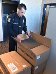 Wayne Police Chief checks on his department's order of new cameras for its officers' vehicles.