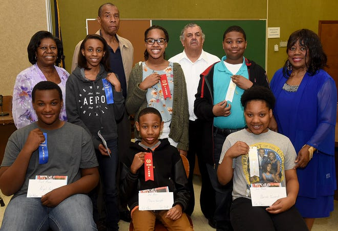 The Retired Educators Association of St. Landry Parish held their annual Black History Quiz Bowl on Saturday, March 23, at the Resource Center. Top winners in the event were, from left seated, Nigel Poole, Sunset Middle School first place; Chance Van Right, Lawtell Elementary second place; and Mariah Toussaint, Washington Elementary third place. Second row from left, Dr. Savoynne Williams, REA president; Alyssa Baggs, Grolee Elementary first place; Lauren Polk, Grolee Elementary second place; Gregory Campbell, Grolee Elementary third place; and Hazel Red, quiz bowl co-chairman. Back row from left, Jonathan Williams, quiz bowl co-chairman and Jimmy Auzenne, REA member. This year marks the 20th anniversary of the Black History Quiz Bowl sponsored by the Retired Educators Association of St. Landry Parish.