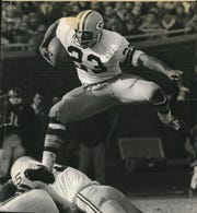 Travis Williams finds the shortest distances is a straight line as he hurdles teammate Jim Flanigan en route to a kickoff return against the Bears in 1967.