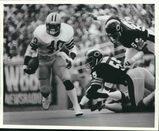 Eddie Lee Ivery of the Green Bay Packers broke through a hole during first quarter action against the Chicago Bears Sunday at Soldier Field, Chicago.  Bears Gary Campbell (59) and Otis Wilson (55) couldn't bring down Ivery, who left the game later with a knee injury.  The Packers beat the Bears, 16-9.
