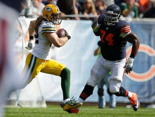 Green Bay Packers outside linebacker Clay Matthews (52) returns an interception during the 4th quarter of the Green Bay Packers' 31-23 win against the Chicago Bears on Sunday, September 13, 2015 at Soldier Field.